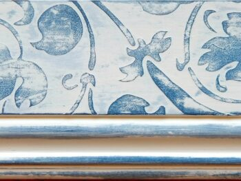Cabinetry stencilled with blue scrolling vine