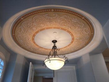 Medallion painted on thin material and installed